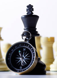 Image of chess pieces and compass